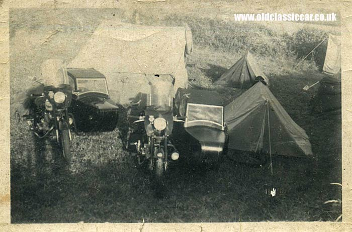 A pair of sidecars parked near some tents