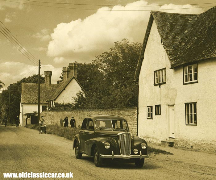 A 1940s/50s Wolseley 4/50 parked in a village
