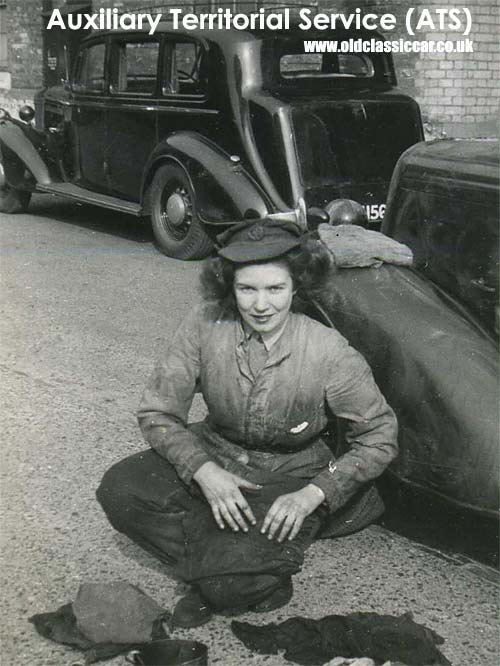 A female ATS mechanic works on a military vehicle
