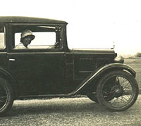 A lady in her Austin 7