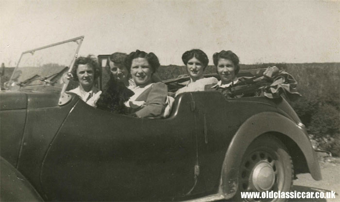 Five ladies sat in their pre-war Austin Eight