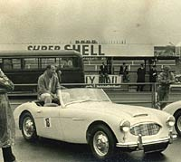 Moss with an Austin-Healey sports car