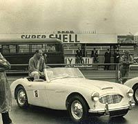 Moss with an Austin-Healey sports car