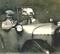 Two people in their Austin 7 tourer