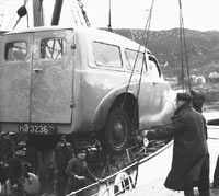 An A40 being loaded onto a ship in the 1950s