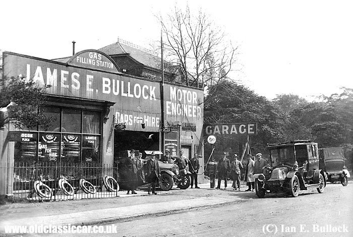 James Bullock's garage with various cars outside