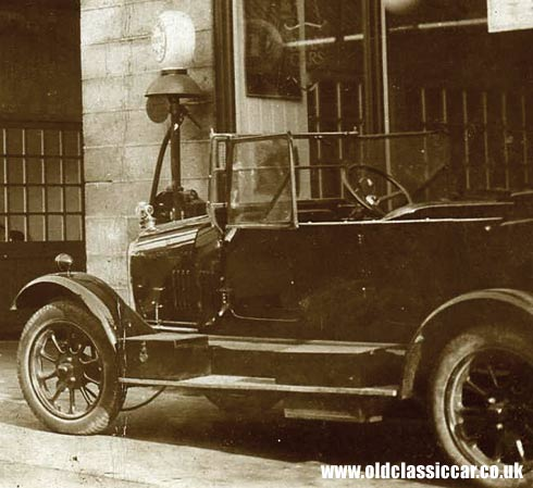 1920s garage, car and petrol pump photo