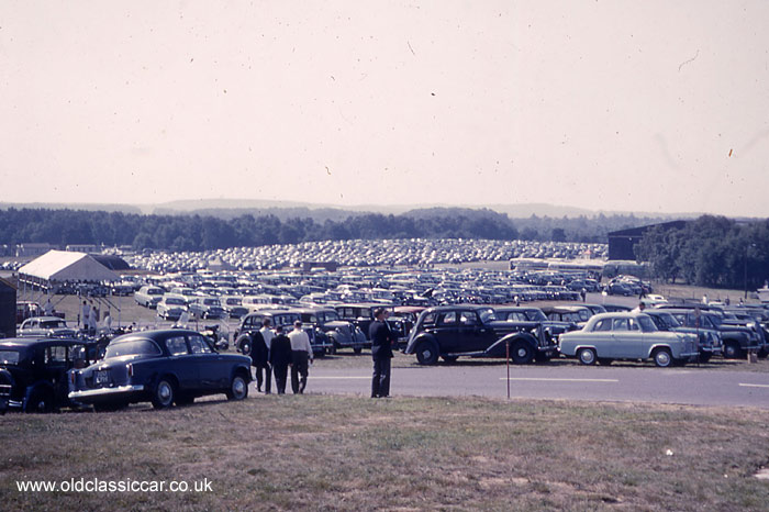 Cars parked in a carpark c1960