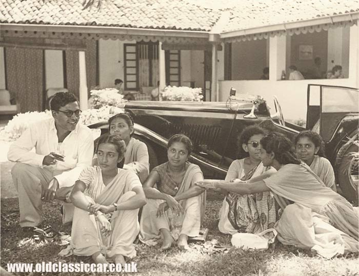 People in Ceylon with an MG sportscar