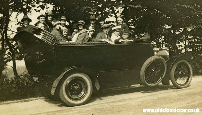A 1920s charabanc parked at the roadside