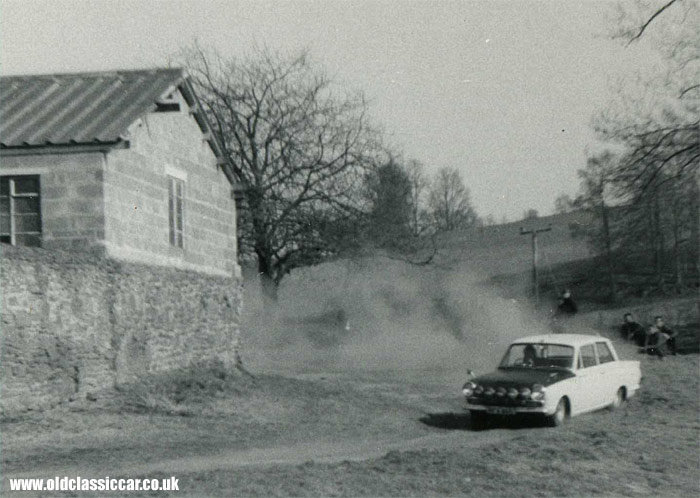 Mark 1 rally car sliding on a rally stage