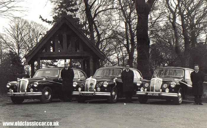 Three Daimlers at a church