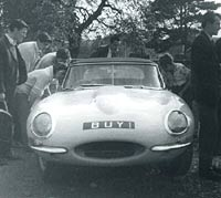A white S1 E-Type Jaguar