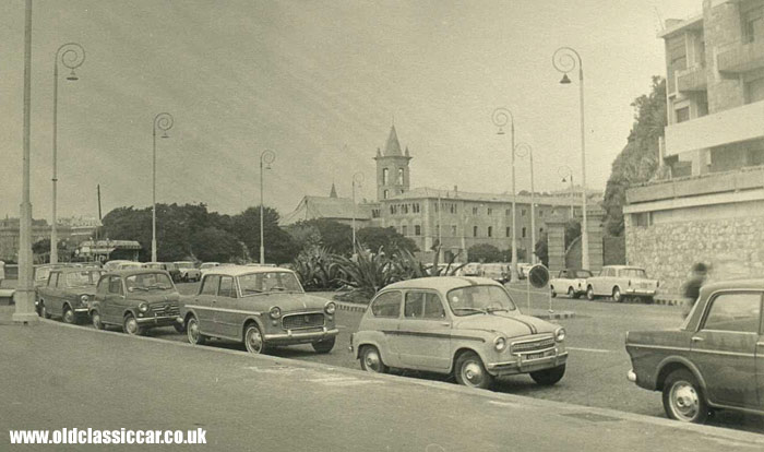 Two Fiat 600s and other cars