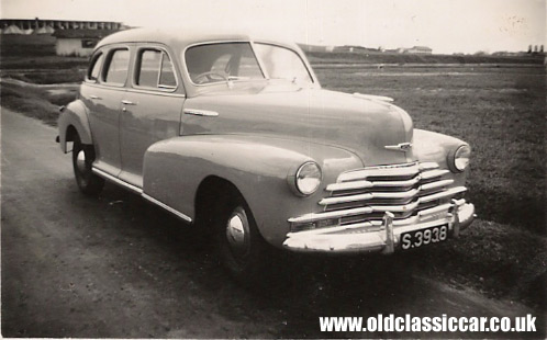 Very nice old photograph that shows a classic Chevrolet sedan