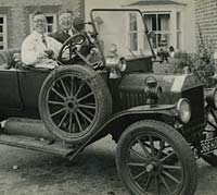 A Model T Ford tourer with passengers