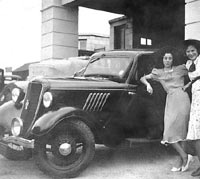 A Ford 8 and two ladies