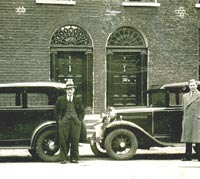 A Model A joined by a later Model B Ford