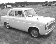 A Ford 100E driving along