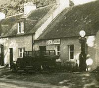 A roadside petrol station of the 1920s