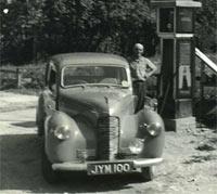 1948 Hillman at a petrol station