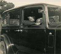 Driver behind the Hillman's steering wheel