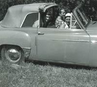 Three people in a Hillman Minx