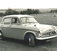 The Hillman parked in a field