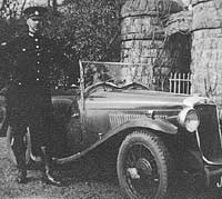 A Hillman with a police officer