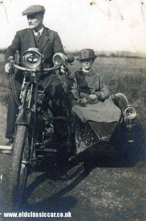 An Indian motorcycle with sidecar attached