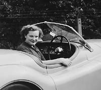 A driver in her XK120 sportscar