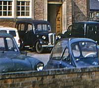 A Bradford and other classics outside a hotel