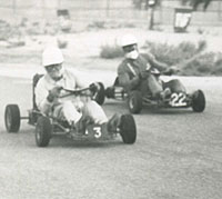Three karts go wheel-to-wheel