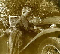 Another view of the boy working under the MG's bonnet