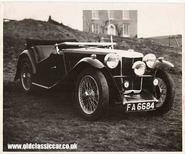 MG TC with old manor house in the background