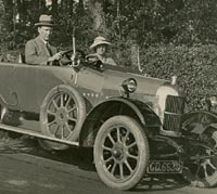 People sat in a 1922 or 1923 Cowley four-seater tourer