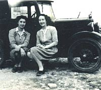Vintage Morris Minor with two ladies for company