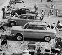 NSU Prinz car parked on a beach