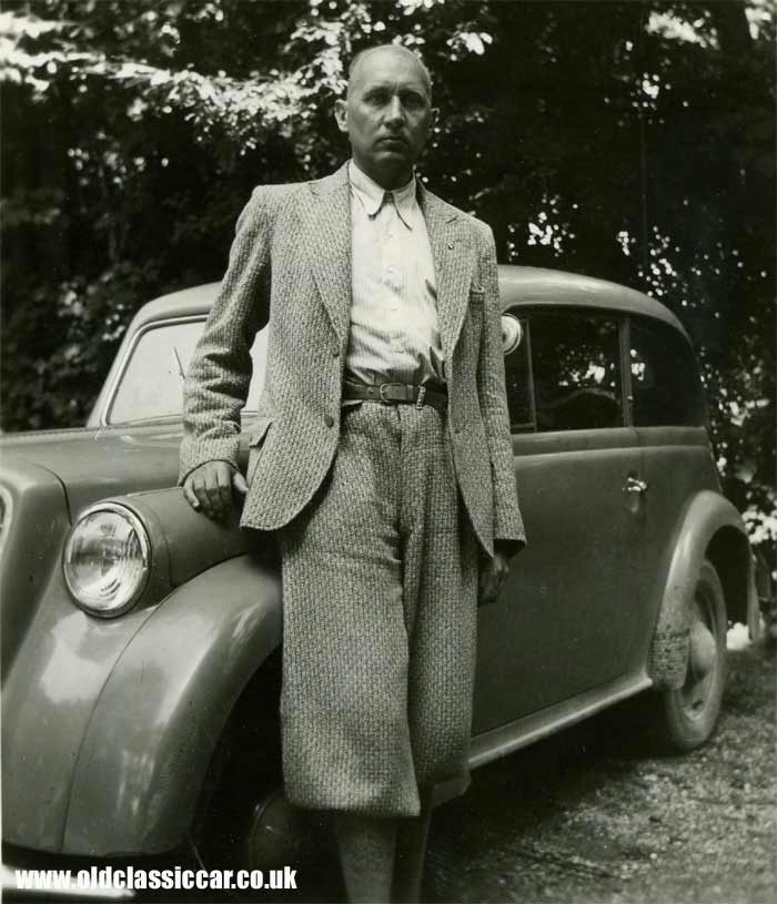 A proud car owner with his 1935/1936 Opel car