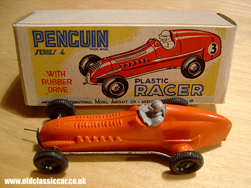Penguin (FROG) rubber-band powered toy racing car