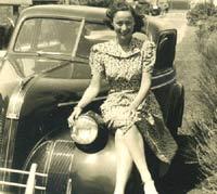 Young lady sat on a classic Pontiac car