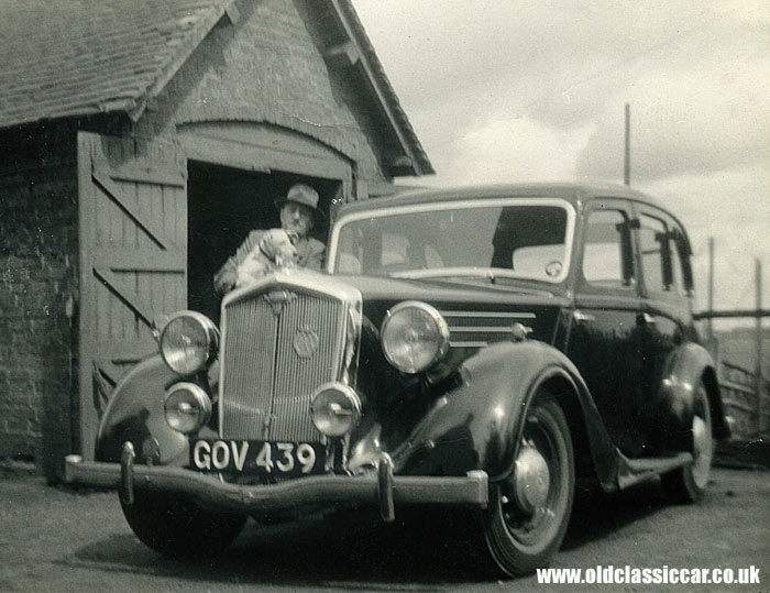 A pre-war Wolseley with it's owner