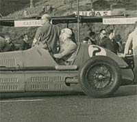 A 1930s Maserati racing car photographed at speed