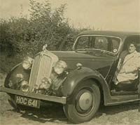 Two ladies and a P2 Rover car