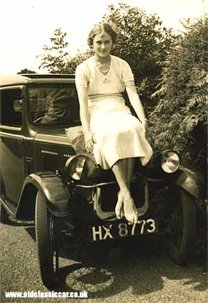 A young lady sat on an Austin 7