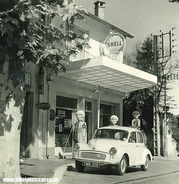 A Shell garage in France, with a Minor parked outside