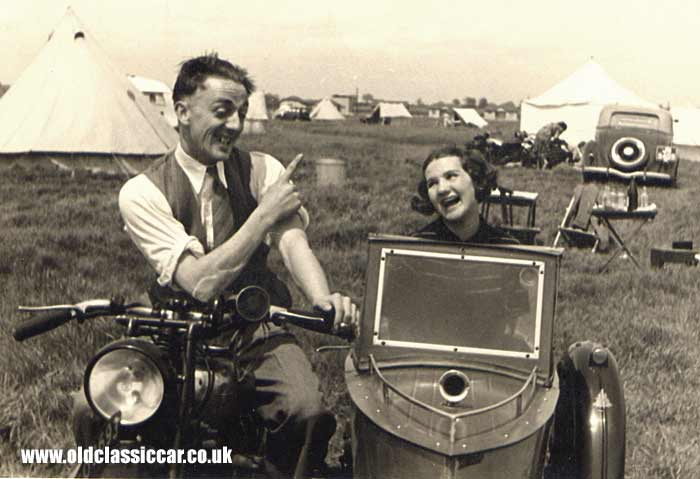Two people and their sidecar combination in 1938