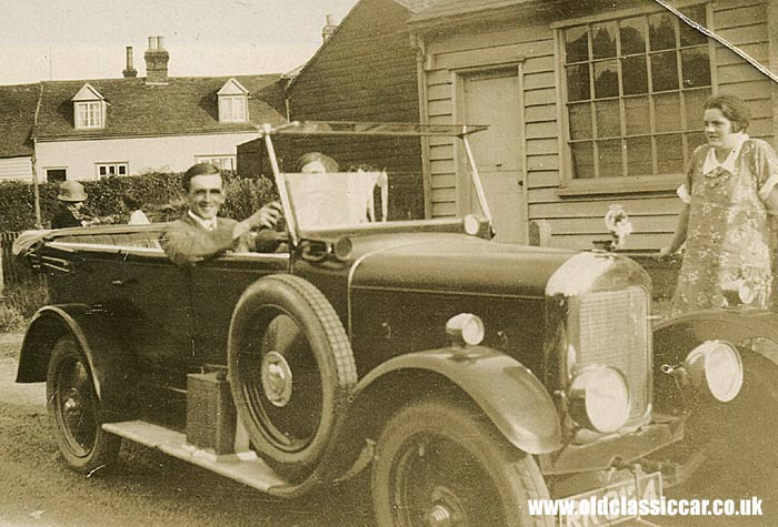 A vintage Singer Ten with its driver behind the wheel