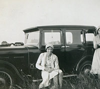 The 1931 Singer parked in a field