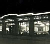 Stewart & Ardern's Morris car dealership at night